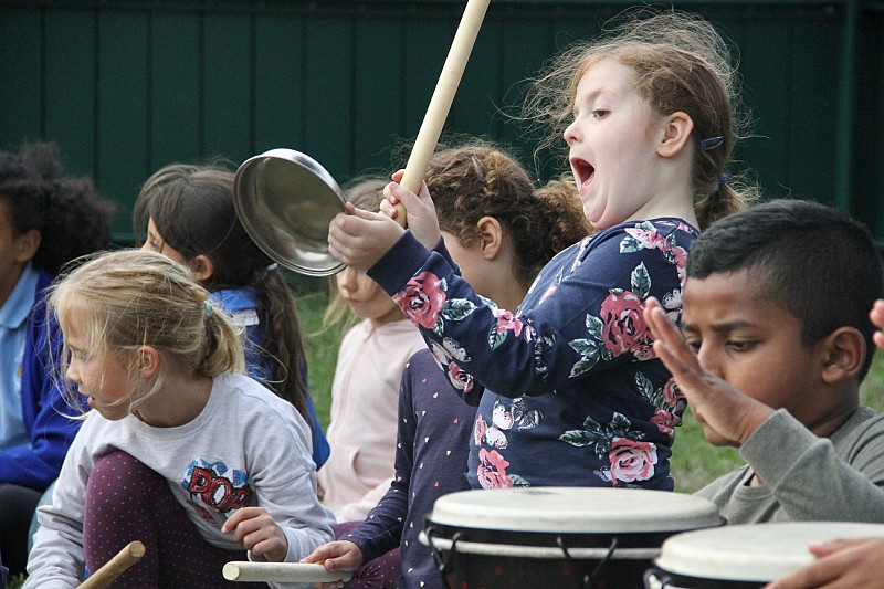 Girl having fun drumming