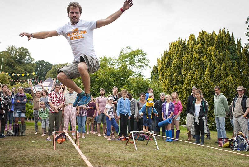 A person balancing on a slackline