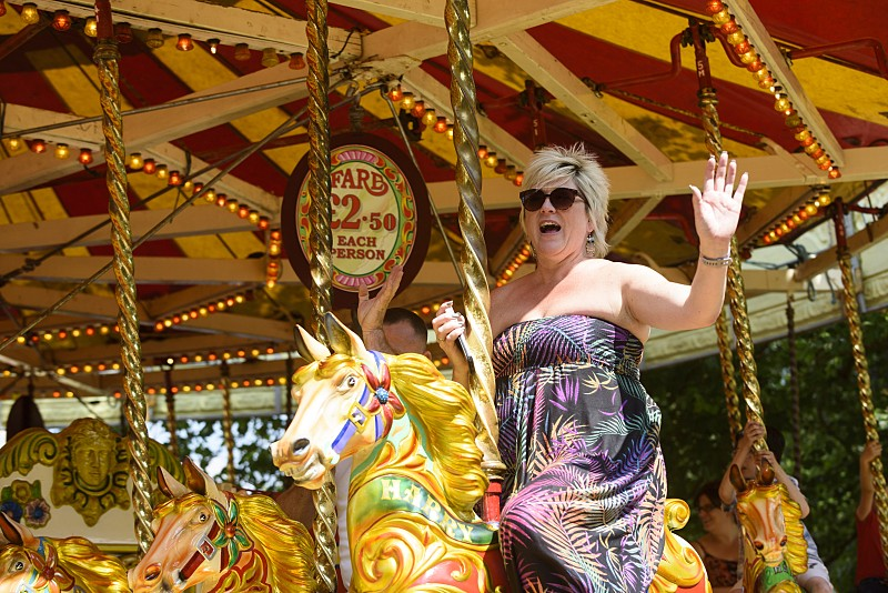 Woman on a carousel ride